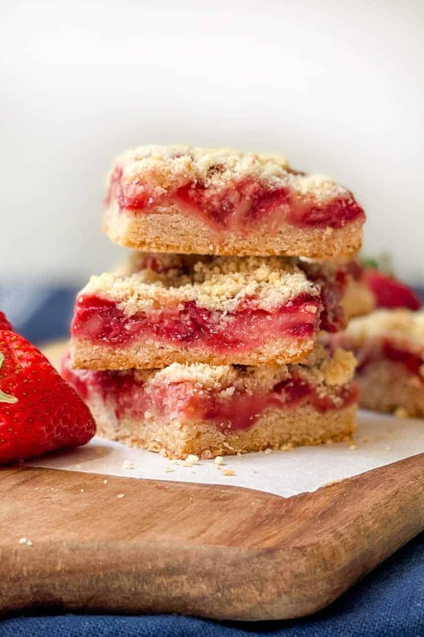 Stacked Strawberry Crumble Squares with a white background.