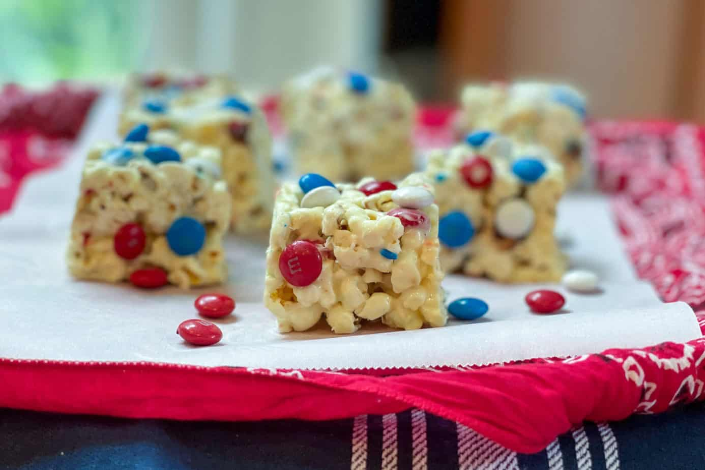 Squares of M&M Popcorn Treats on a Red Bandanna