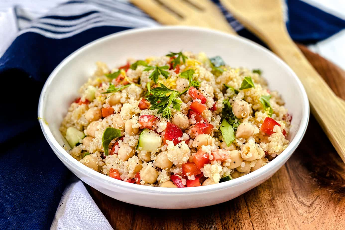 Quinoa Salad in a White Bowl with Wood Service