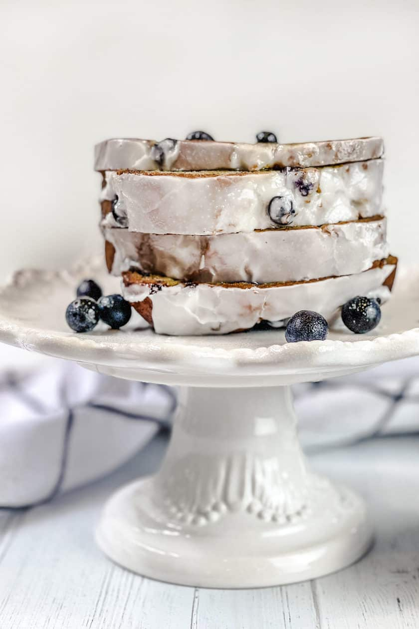 Sliced Blueberry Banana Bread on a White Cake Plate