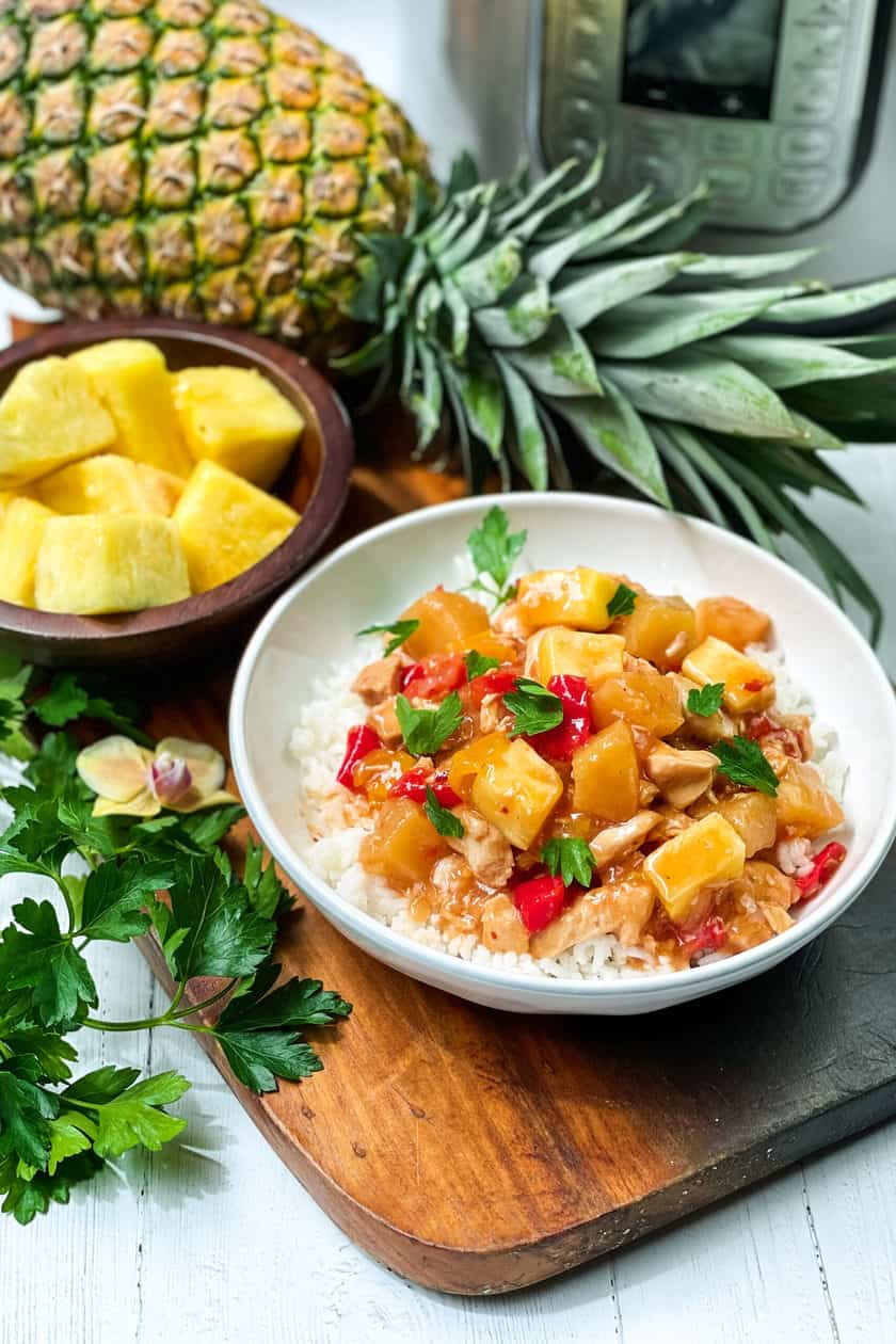 Side view of Instant Pot Pineapple Chicken in a white bowl