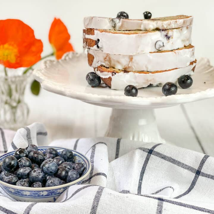 Horizontal view of Blueberry Banana Bread with poppies
