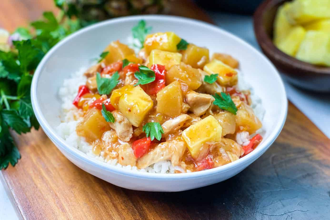 Bowl of Instant Pot Pineapple Chicken over white rice