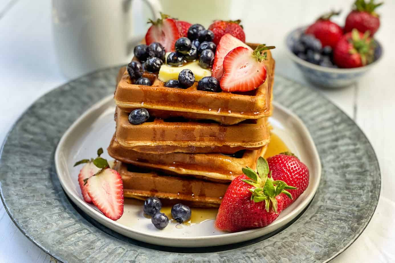 Closeup of Whole Wheat Waffles Stacked with Strawberries and Blueberries