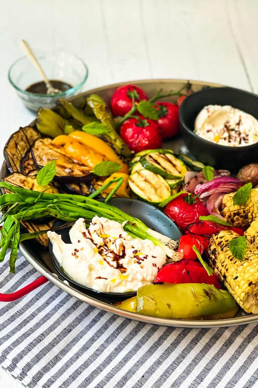 side view of Grilled Vegetables Platter with cheese.