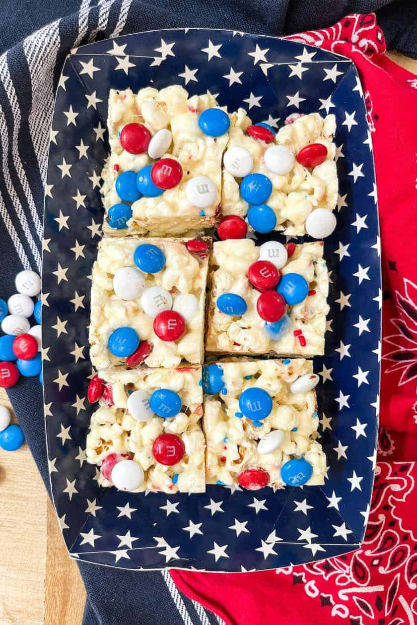 Squares of M&M Popcorn Treats in a Blue Star Container