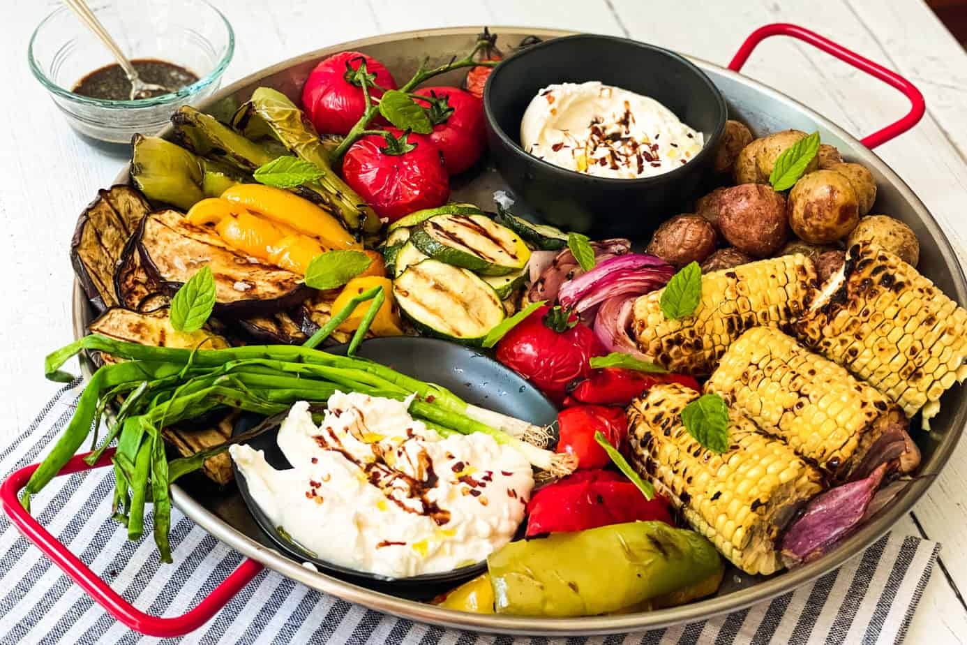 Grilled Vegetables with Burrata Cheese on a serving platter.