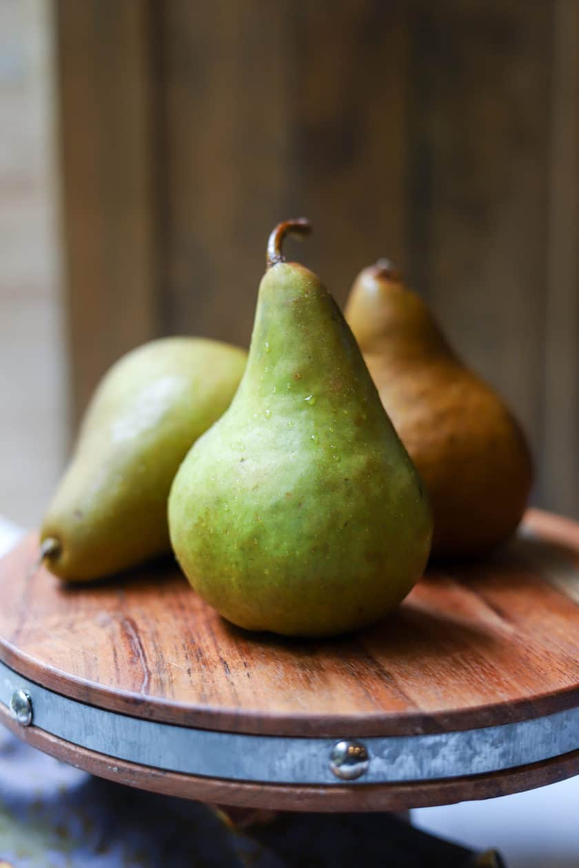 Bosc pears on a wood stand