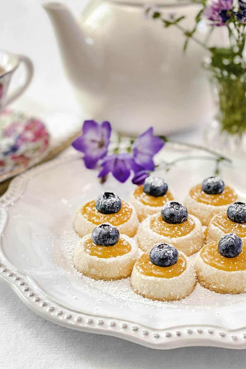 Closeup view of Shortbread Tea Cookies with Lemon Curd and Blueberries