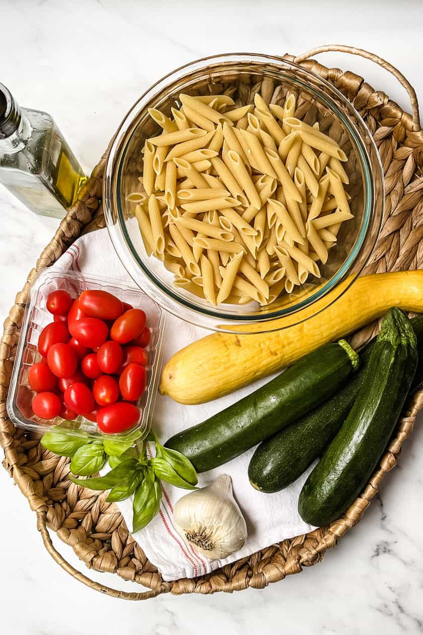 Raw ingredients for Zucchini Pasta in a basket