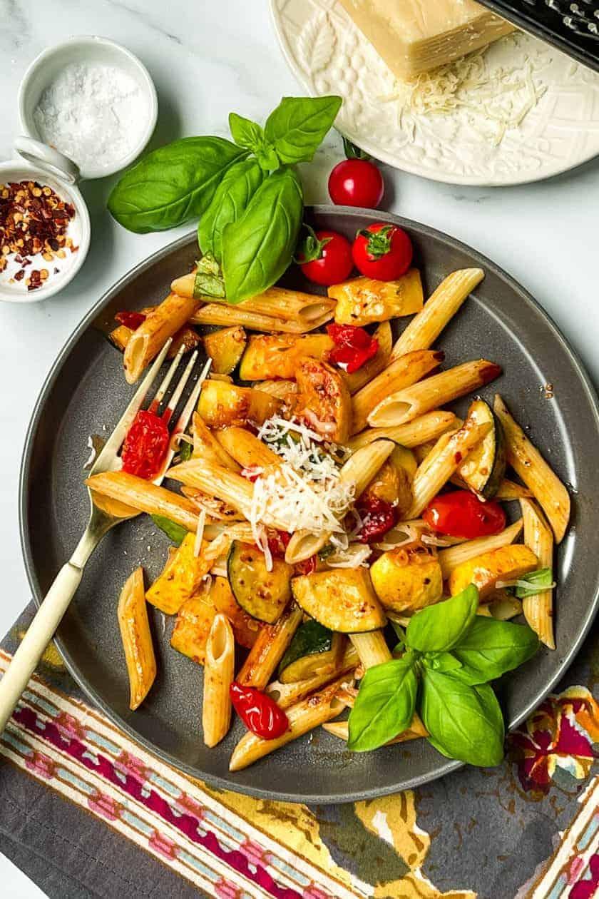Zucchini Pasta with fork on dark grey plate
