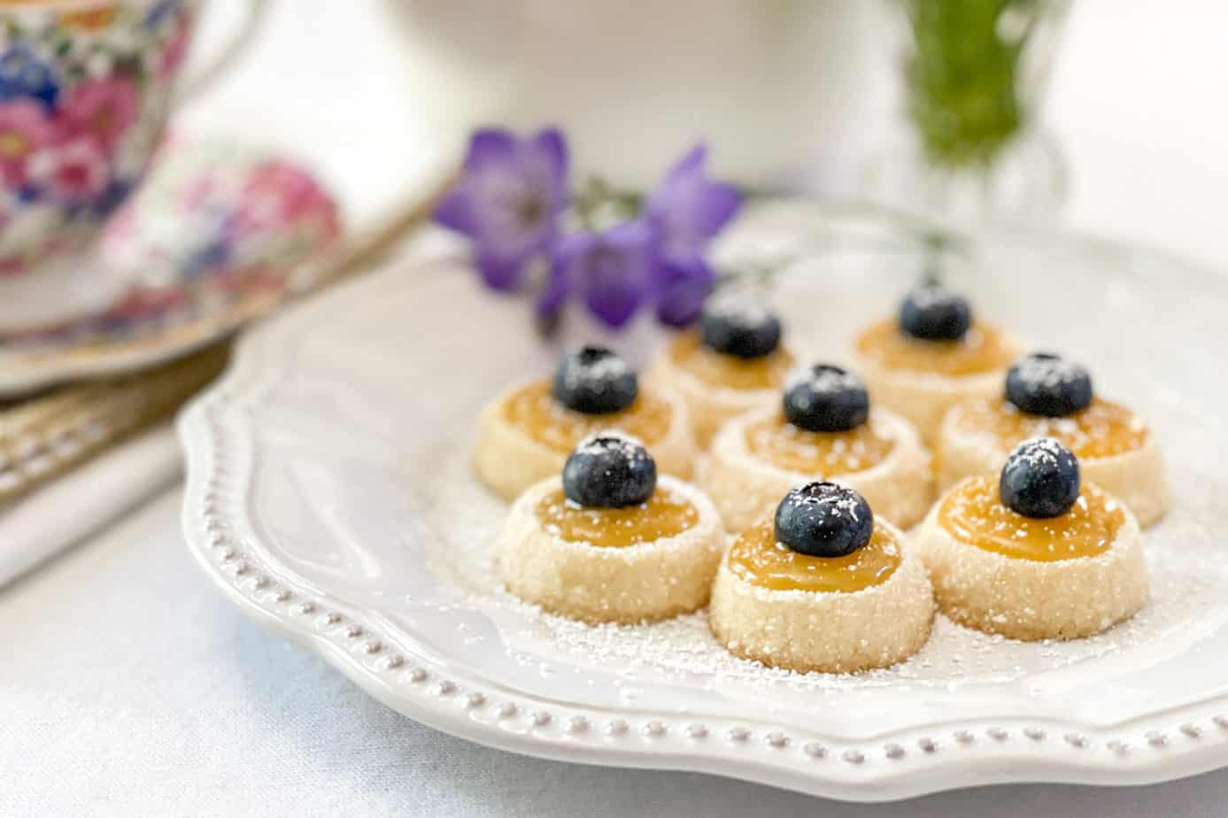 Shortbread Tea Cookies with Lemon Curd on a Tea Plate with Flowers