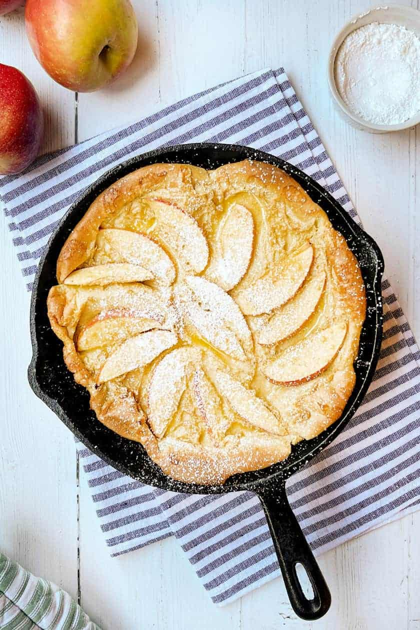 Top view of Apple Dutch Baby in a cast iron skillet