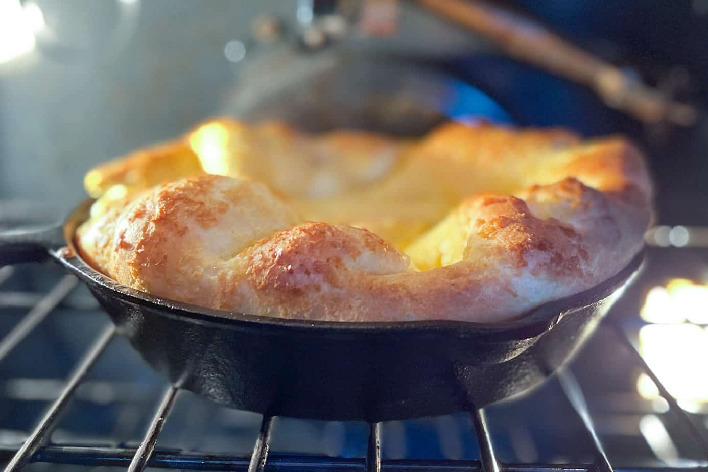 Apple Dutch Baby in the oven and puffed