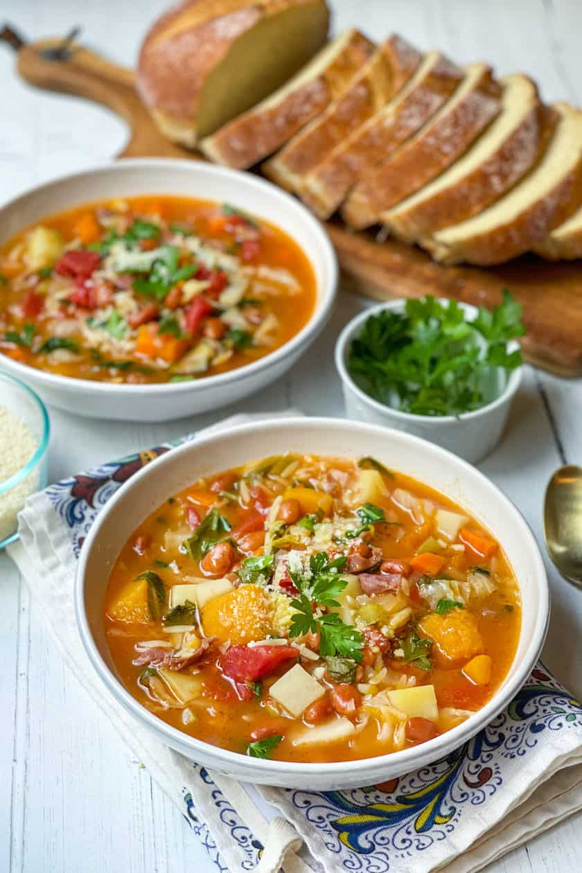 Side view of bowls of Minestrone Soup with Sliced Bread